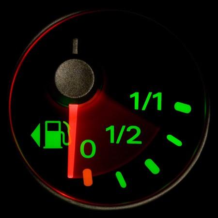 gas gauge: A gas gauge shows petrol level on a black background