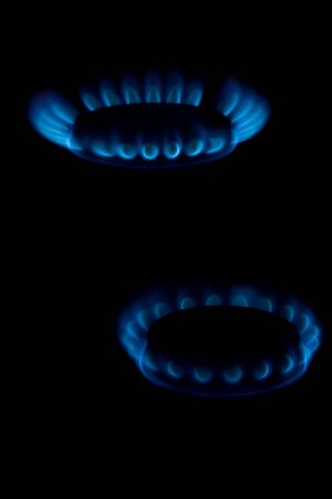 Blue flame of gas on a black background photo