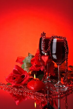 Two glasses of wine, rose and heart on a red background. Valentines day card. Stock Photo - 4096442