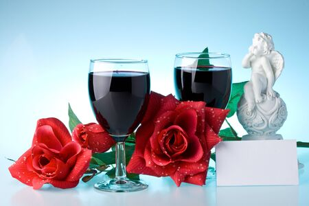 loveliness: Two glasses of wine, rose and the cupid on a blue background