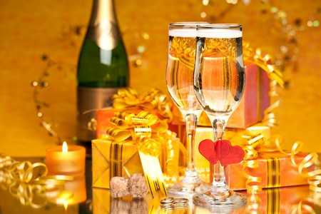 alcohol cardboard: Decoration with gift boxes and champagne glasses Stock Photo