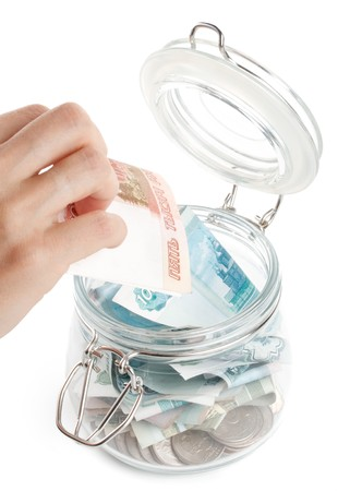 Money in a pot. Home banking concept. Stock Photo - 4142086