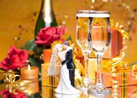 Decoration with gift boxes and champagne glasses photo