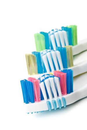 Various tooth brushes on a white background Stock Photo - 4142154