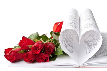 Pages of a book curved into a heart shape and red roses. Valentines day card. photo