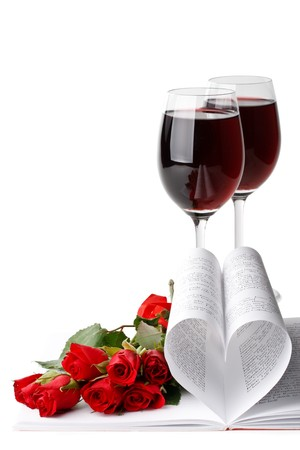 rose wine: Pages of a book curved into a heart shape and red roses. Valentines day card.