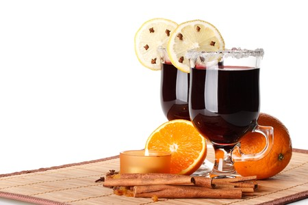 punch spice: Two glasses of mulled wine, orange and spices on a white background Stock Photo