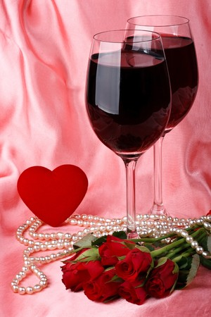 Two glasses of red wine, pearls, heart and bouquet of roses Stock Photo - 4178745