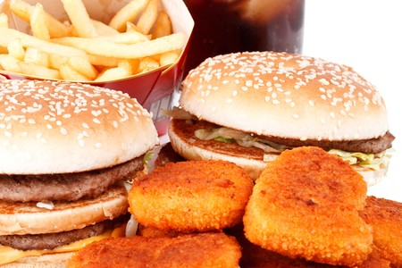 Hamburger, french fries, chicken nuggets and cola on a white background Stock Photo - 4178743