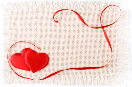 Two hearts and red tape on a canvas. Valentines day card. Stock Photo - 4178733