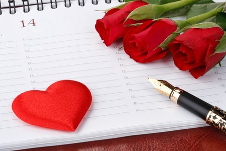 Red roses, heart, fountain pen and calendar page. Valentines day card. photo