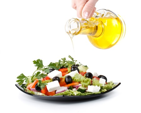 Appetizing greek salad on a plate. Close up. photo