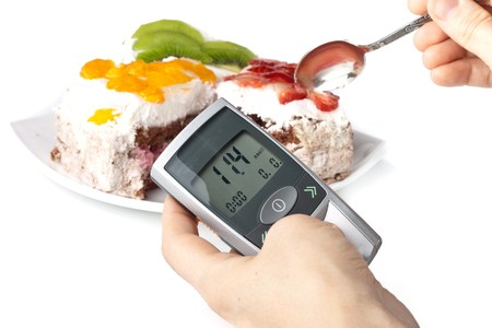 A diabetic looking at a reading on a glucose level monitor