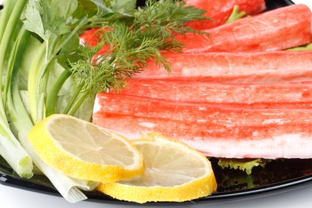 crabmeat: Crabmeat sticks with vegetables on a white background