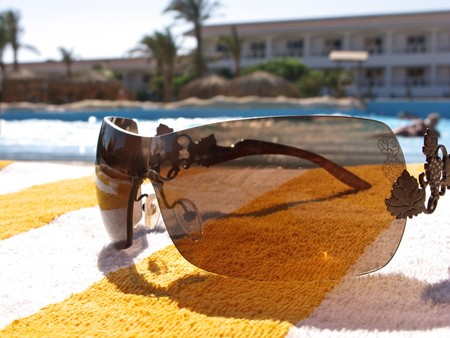 Pool reflexion in sunglasses. Close up. Selective focus. Stock Photo - 4212198