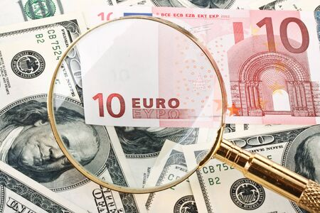 Money and magnifier. Exchange rate financial concept. photo