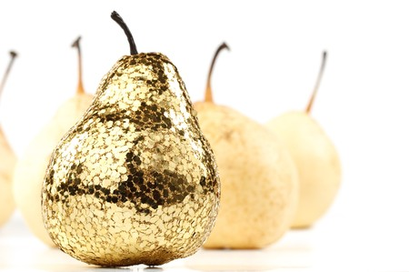 usual: Gold pear among the usual. Concept for success.