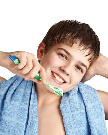 Caucasian boy cleans a teeth on a white background. Close up. photo