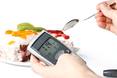 self exam: A diabetic looking at a reading on a glucose level monitor