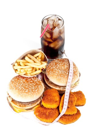 Hamburger, french fries, chicken nuggets, cola and measuring tape on a white background Stock Photo - 4284309