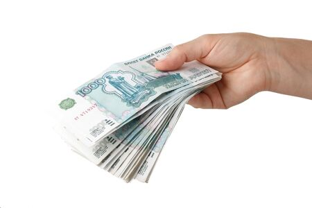roubles: Hand with money  on a white background