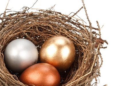 Gold, silver and bronze eggs in a real nest Stock Photo - 4338771