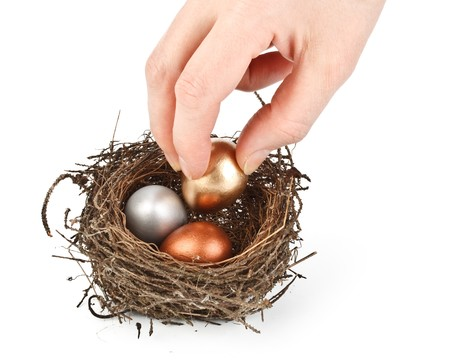 Gold, silver and bronze eggs in a real nest Stock Photo - 4338737