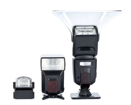 Various automatic flashes on a white background photo
