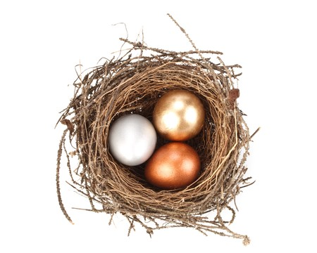 Gold, silver and bronze eggs in a real nest Stock Photo - 4345590