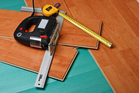 Repair of a floor covering. Abstract background.
