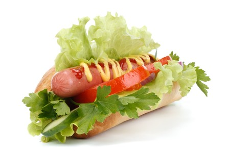 catsup: Hot dog with vegetables on a white background