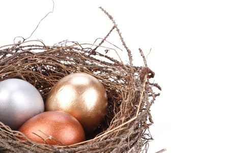 Gold, silver and bronze eggs in a real nest Stock Photo - 4359940