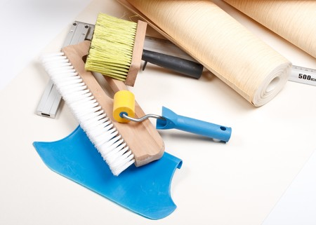 smoother: Still-life from various wallpapering tools. Home renovation.