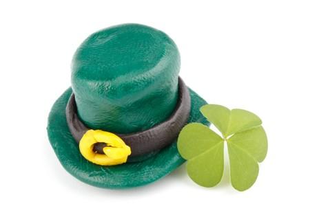 Three leaf clover and Green Leprechaun Hat on a white background. St. Patricks Day symbol. photo