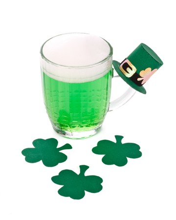 Mug of Green beer, shamrock and Leprechaun hat for St Patrick's Day Stock Photo - 4402650