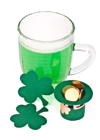 Mug of Green beer, shamrock and Leprechaun hat with coins for St Patrick's Day Stock Photo - 4402706