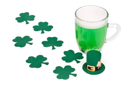 Mug of Green beer, shamrock and Leprechaun hat for St Patrick's Day Stock Photo - 4402654