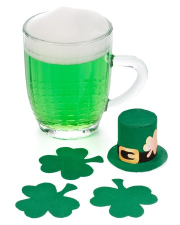 Mug of Green beer, shamrock and Leprechaun hat for St Patrick's Day Stock Photo - 4432470
