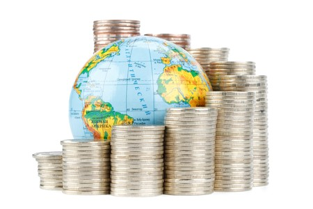 Diagram of growth from coins and globe on a white background. Global business concept. photo