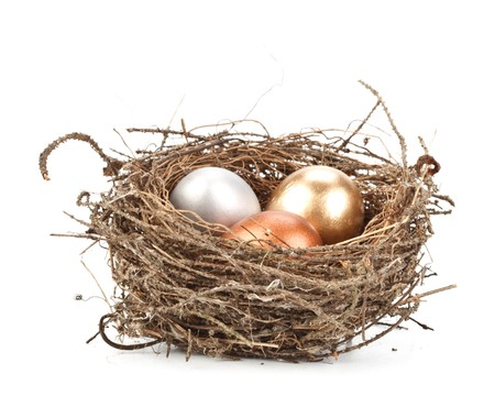 Gold, silver and bronze eggs in a real nest Stock Photo - 4432630