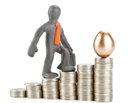 Diagram of growth from coins, gold egg  and plasticine businessman Stock Photo - 4432615