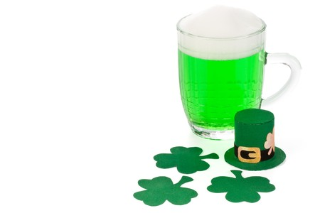 Mug of Green beer, shamrock and Leprechaun hat for St Patrick's Day Stock Photo - 4432541