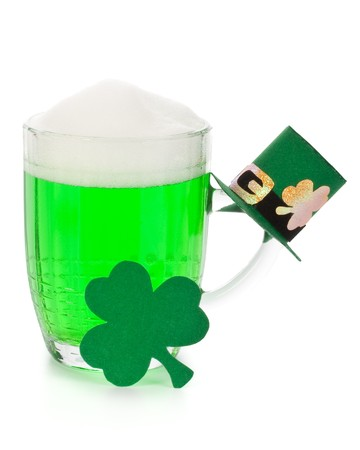 Mug of Green beer, shamrock and Leprechaun hat for St Patricks Day photo
