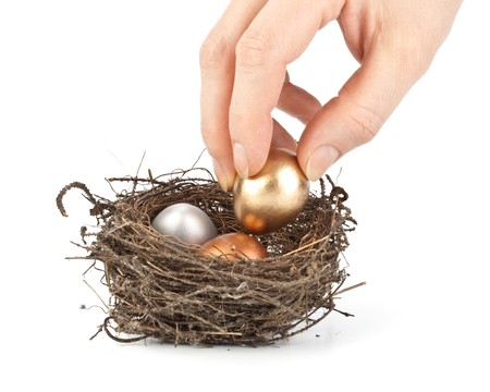 Gold, silver and bronze eggs in a real nest Stock Photo - 4453508