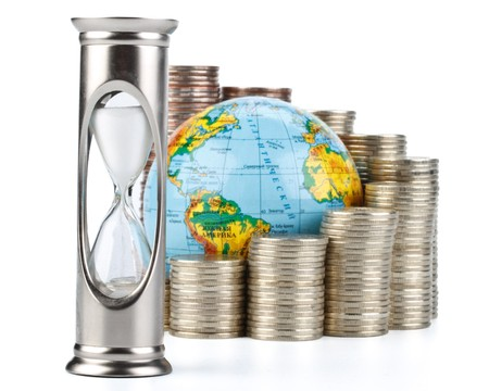 Diagram of growth from coins, hourglass and globe on a white background. Time is money concept. photo