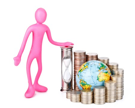 Diagram of growth from coins, hourglass, globe and plasticine businessman on a white background. Time is money concept. photo