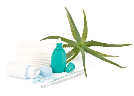 Medical products, handkerchiefs and aloe on a white background. Cold treatment. photo