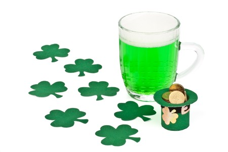 Mug of Green beer, shamrock and Leprechaun hat with coins for St Patrick's Day Stock Photo - 4485397