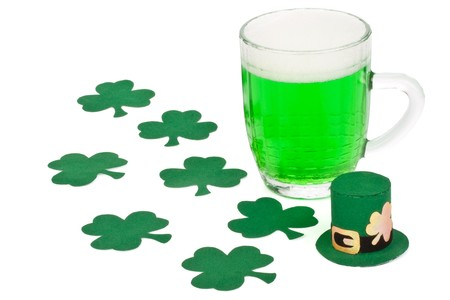 Mug of Green beer, shamrock and Leprechaun hat for St Patrick's Day Stock Photo - 4485396