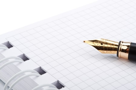 Black classical fountain pen and notebook on a white background photo